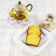 Fresh Lemon Pound Cake with Green Tea on table  — Stock Photo