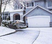 Snow on Driveway leading to home — Stock Photo