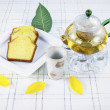 Green Tea and Cake on Table with with flower leafs — Stock Photo
