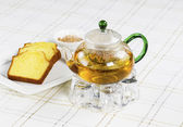 Fresh Green Tea in Glass Pot with snack food — Stock Photo
