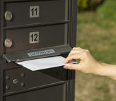 Sending letter to outgoing postal mailbox — Stock Photo