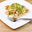 Pasta with shrimp and herbs in white dish — Stock Photo