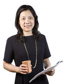 Mature Asian Woman in Business attire with report and coffee cup — Stock Photo