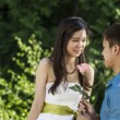 Young Adult Man offering Rose to his Girlfriend — Stock Photo