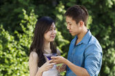 Young Adult Couple Sharing Drinks Outdoors — Stockfoto
