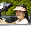 Mature woman sitting in Convertible Car on Nice Day  — Stock Photo