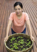Mature woman working on home garden — Stock Photo