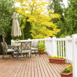 Outdoor Natural Cedar Deck with patio furniture — Stock Photo