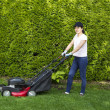 Mature WomPreparing to work on Grass Yard — Stock Photo #26184569