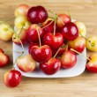 Yellow and Red Cherries in White Plate — Stock Photo