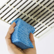 Cleaning Bathroom Fan Vent Cover with Sponge  — Stock Photo