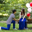 Stock Photo: Young Adult Man Proposing to his Lady