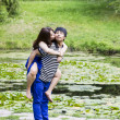 Lady Kissing her Lover in Front Pond — Stock Photo #29850635