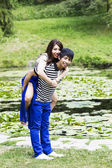 Young Adult having fun at the Pond — Stock Photo