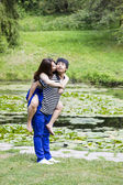 Lady Kissing her Lover in Front Pond — Stock Photo