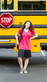 Young Girl Student Standing next to side of Bus — Stock Photo