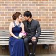 Lovers looking at each other while sitting on bench — Stock Photo