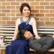 Young Adult Couple Resting on Wooden Bench — Стоковое фото #30419369