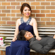 Young Adult Couple Resting on Wooden Bench — Stok fotoğraf #30419369