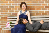 Young Adult Couple Resting on Wooden Bench — Stock Photo