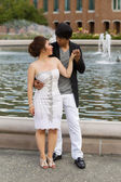 Young Adult Couple Holding Hands Near the Water Fountain — Stock Photo