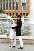Young Couple Enjoying Each Other at the Water Fountain — Stock Photo