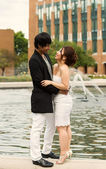 Young Adult Couple Hugging in Front of Water Fountain — Stock Photo