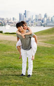 Young Lovers having fun outdoors — Stock Photo