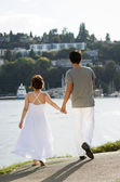 Lovers Walking on Path in Harbor — Stock Photo
