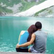 Stock Photo: Young Adults Lovers Looking at Pristine AquMountain Lake