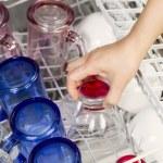 Loading the Dishwasher with glassware — Stock Photo #32501575