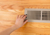 Opening up Floor Vent Heater — Stock Photo
