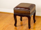 Leather footstool on traditional Oak floors — Stock Photo