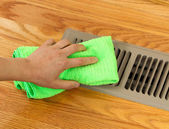 Hand Cleaning Grill Plate of Floor Heating Vent in Home — Stock Photo