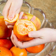 Peeling Orange Fruit by Hand — Foto Stock #33206401