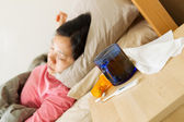 Woman Resting in bed while sick — Stock Photo