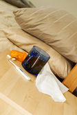 Night Stand with Medicine Stuff on it — Stock Photo