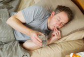Man taking Pill for cold — Stock Photo