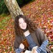 Young Teenage Girl outside reading a book during Autumn Season — Stock Photo