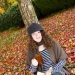 Teen Girl Enjoying the Autumn Season — Stock Photo #35028593