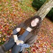 Teen Girl Relaxing Outdoors during the Autumn Season  — Stock Photo