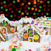 Bright Night Time Lights behind Gingerbreadh Houses during the H — Stock Photo