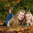 Sisters Having fun on an Autumn Day — Stock Photo #35348455