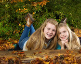 Sisters Having fun on an Autumn Day — Stock Photo