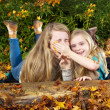 Sisters having fun in the fall season — Stock Photo