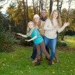 Family Dancing during a nice Autumn Day in the park — Stock Photo