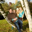 Happy Family Resting Outdoors during a nice day in fall season — Stock Photo
