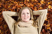 Happy Adult Woman enjoying the autumn season — Stockfoto