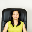 Mature Woman Relaxing in Massage Chair — Stock Photo #36290865