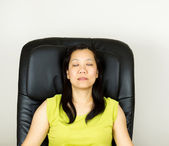Mature Woman Relaxing in Massage Chair — Stock Photo